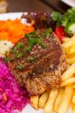 Конец стейка мяса вверх Стоковая Фотография RF