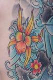 Конец татуировки цветка лотоса вверх Стоковое фото RF