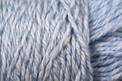 Конец текстуры пряжи сини и белизны младенца вверх Стоковое Изображение