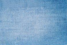 Конец ткани ткани голубых джинсов Стоковое фото RF