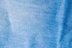 Конец ткани ткани голубых джинсов Стоковое Фото