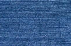 Конец ткани ткани голубых джинсов Стоковое Изображение