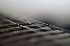 Конец fingerboard гитары вверх Стоковая Фотография