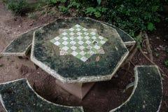 Конкретные таблица и стулья с шахматной доской Стоковая Фотография