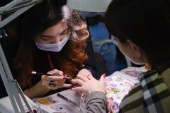Конкуренция стилизаторов ногтя в Казахстане astana 10-ое ноября 2017 Стоковые Изображения RF