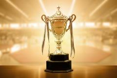 Конкуренция трофея золота положенная на таблицу Стоковое Изображение