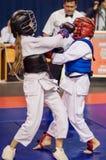 Конкуренция Kobudo между девушками Стоковое Изображение