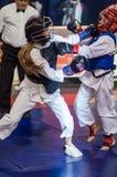 Конкуренция Kobudo между девушками Стоковая Фотография