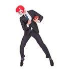 Конкурсный бизнесмен играя американский футбол Стоковые Фотографии RF