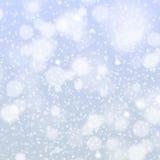 Конспект вектора предпосылки снежинок рождества голубой светлый Стоковое фото RF
