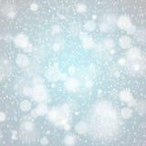 Конспект вектора предпосылки снежинок рождества голубой светлый Стоковая Фотография