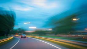 Конспект запачканный автомобиля на дороге Стоковая Фотография