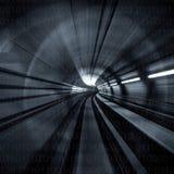 Конспект нерезкости движения - в подземной рубрике тоннеля к свету черная белизна Стоковая Фотография