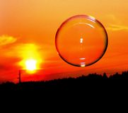 Конспект пузыря на ноче в комплекте солнца Стоковые Фото