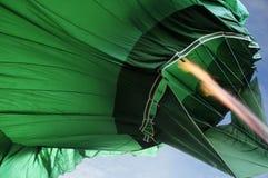Конспект - пламя от зеленого горячего воздушного шара Стоковое Изображение