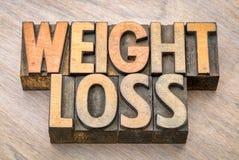 Конспект слова потери веса в типе древесины letterpress стоковые фотографии rf