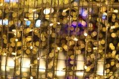 конспект цвета золота света нерезкости красочных и сада ночи стоковые фото