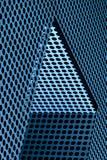 Конспект черных точек против голубой металлической поверхности стоковая фотография rf