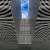 Конспект черных точек против металлической поверхности стоковая фотография