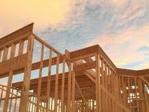 Конструкция нового дома на заходе солнца Стоковые Фотографии RF