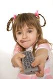 контролируйте девушку держа дистанционный tv Стоковая Фотография