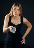 контролируйте дистанционную женщину стоковые изображения rf