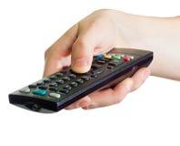 контролируйте remote удерживания руки Стоковые Фото