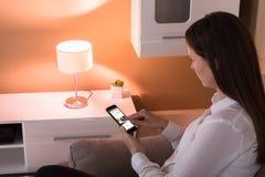 Контролируя свет с применением стоковые изображения