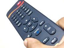 контролируйте remote удерживания руки стоковое фото rf
