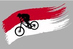 Контур велосипедиста на флаге Индонезии стоковое фото rf