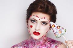 Конфета искусства стороны женщины стоковая фотография