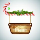 Конфета рождества с деревянной доской Стоковое Изображение RF