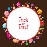 Конфета хеллоуина с фокусом или обслуживанием на круглой рамке Стоковые Фото