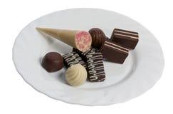 Конфета шоколада в тарелке стоковое изображение