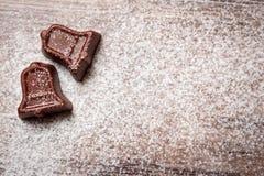 Конфета шоколада в форме колокола рождества с напудренным сахаром Стоковые Фото