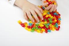 конфета grabing Стоковые Фотографии RF
