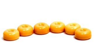Конфеты карамельки на белизне Стоковое Фото
