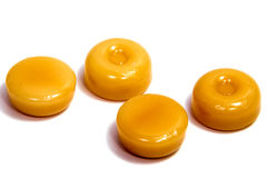 Конфеты карамельки на белизне Стоковые Фото