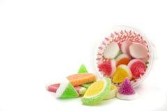 Конфеты конфеты студня в плите на предпосылке Стоковые Фото