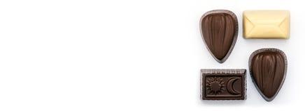 Конфеты шоколада на белизне Стоковые Изображения