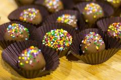 Конфеты bonbons шоколада с брызгают Стоковая Фотография