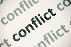 Конфликт слова напечатанный на бумажном макросе Стоковые Изображения