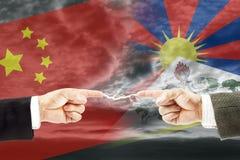 Конфронтация и вражда между Китаем и Тибетом стоковое фото