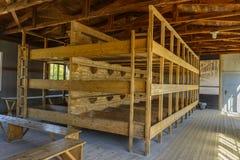 Концентрационный лагерь Dachau, деревянные кровати стоковое изображение