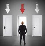 Концепция бизнесмена выбирая правую дверь стоковое фото rf