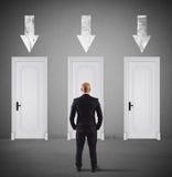 Концепция бизнесмена выбирая правую дверь стоковая фотография rf