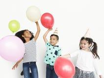 Концепция воздушного шара партии маленьких детей Стоковые Фотографии RF