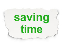 Концепция времени: Время сбережений на бумажной предпосылке Стоковые Фото