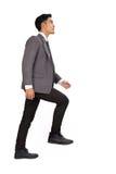 Концепция гоноров с лестницами бизнесмена взбираясь Стоковое Фото