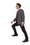 Концепция гоноров с лестницами бизнесмена взбираясь Стоковая Фотография RF